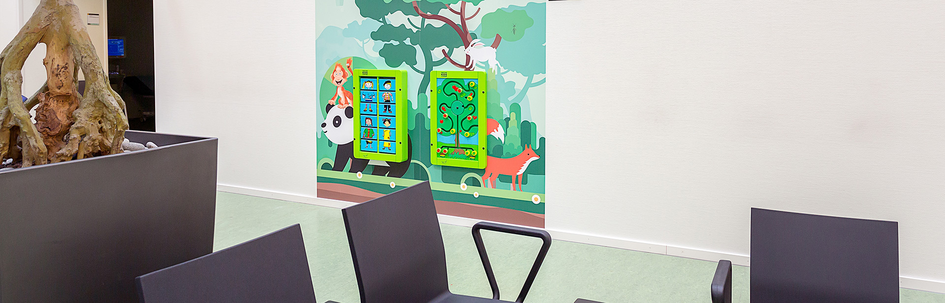 this image shows a kids corner with wall games in a hospital